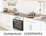 stylish kitchen interior with... | Shutterstock . vector #1240554451