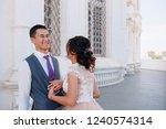 bride and groom posing in the... | Shutterstock . vector #1240574314