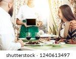 girl waiter takes an order from ...   Shutterstock . vector #1240613497