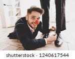 man lying on floor and tying...   Shutterstock . vector #1240617544