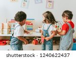 young children playing with... | Shutterstock . vector #1240622437