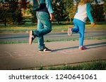 Boy And Girl Play Hopscotch On...