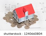 small house model on coins | Shutterstock . vector #1240660804