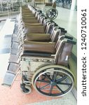 group of wheelchairs parked in... | Shutterstock . vector #1240710061