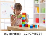 little child girl plays with...   Shutterstock . vector #1240745194