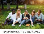 group of young students sitting ...   Shutterstock . vector #1240746967