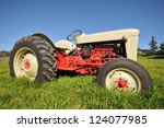 An Old Antique Tractor In A...