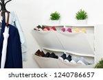 shoe cabinet with footwear in... | Shutterstock . vector #1240786657