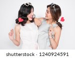 two happy women holding heart... | Shutterstock . vector #1240924591