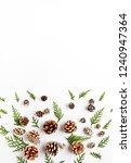 an arrangement of natural cones ... | Shutterstock . vector #1240947364