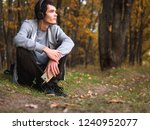 man listening to music in the... | Shutterstock . vector #1240952077