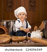 boy in a cook cap among pans... | Shutterstock . vector #124096549