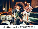 mixed race woman singing and...   Shutterstock . vector #1240979911