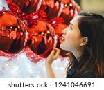 asian woman with christmas tree ... | Shutterstock . vector #1241046691