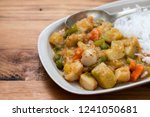 squid stew with boiled rice on... | Shutterstock . vector #1241050681