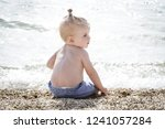candid photo of adorable blonde ... | Shutterstock . vector #1241057284