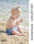 candid photo of adorable blonde ... | Shutterstock . vector #1241057287