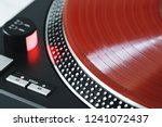 vinyl record closeup. a ray of... | Shutterstock . vector #1241072437
