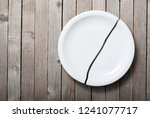 broken porcelain plate on old... | Shutterstock . vector #1241077717