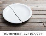 broken porcelain plate on old... | Shutterstock . vector #1241077774
