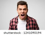 furious enraged man with grumpy ... | Shutterstock . vector #1241090194