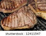 grilled steaks rest on a... | Shutterstock . vector #12411547