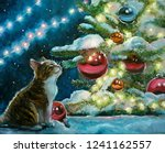 Stock photo  christmas oil painting for cards and greetings the little kitten under the tree looks at glass 1241162557