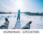 young woman pull sleigh with...   Shutterstock . vector #1241167681