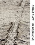Tire tracks on dirt - stock photo