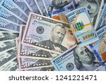 one hundred dollars and fifty... | Shutterstock . vector #1241221471