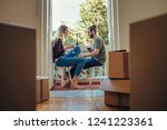 couple sitting in the balcony... | Shutterstock . vector #1241223361