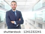 happy business man portrait at... | Shutterstock . vector #1241232241