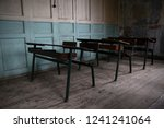 Rows of Vintage Student Desks in An Old Schoolhouse