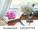 Two Peony And Open Book At...