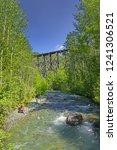 the old wooden bridge over the... | Shutterstock . vector #1241306521