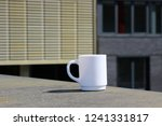 coffee break. white mug on a... | Shutterstock . vector #1241331817