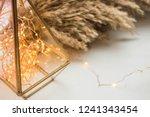 garland in a glass flask....   Shutterstock . vector #1241343454