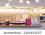 little alarm clock on a table... | Shutterstock . vector #1241413237