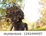 A Mythical Tree Woman Stands I...