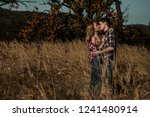 young attractive couple in love ... | Shutterstock . vector #1241480914