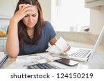 brunette looking worried over... | Shutterstock . vector #124150219