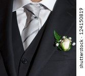 Details of an elegant man with wedding dress - stock photo