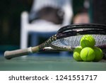 tennis balls and racket in... | Shutterstock . vector #1241551717