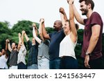 happy diverse people holding...   Shutterstock . vector #1241563447