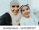 happy muslim mom with little...   Shutterstock . vector #1241589337