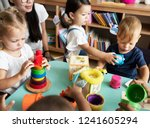 nursery children playing with... | Shutterstock . vector #1241605294