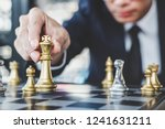 Small photo of Businessman playing chess game reaching to plan strategy for success, thinking for planning overcoming difficulty and achieving goals business strategy for win, management or leadership concept.