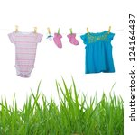 Stock photo baby clothes drying on a rope isolated on white background 124164487