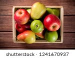 ripe apples and pears in a... | Shutterstock . vector #1241670937