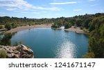 sun glistens on water as... | Shutterstock . vector #1241671147